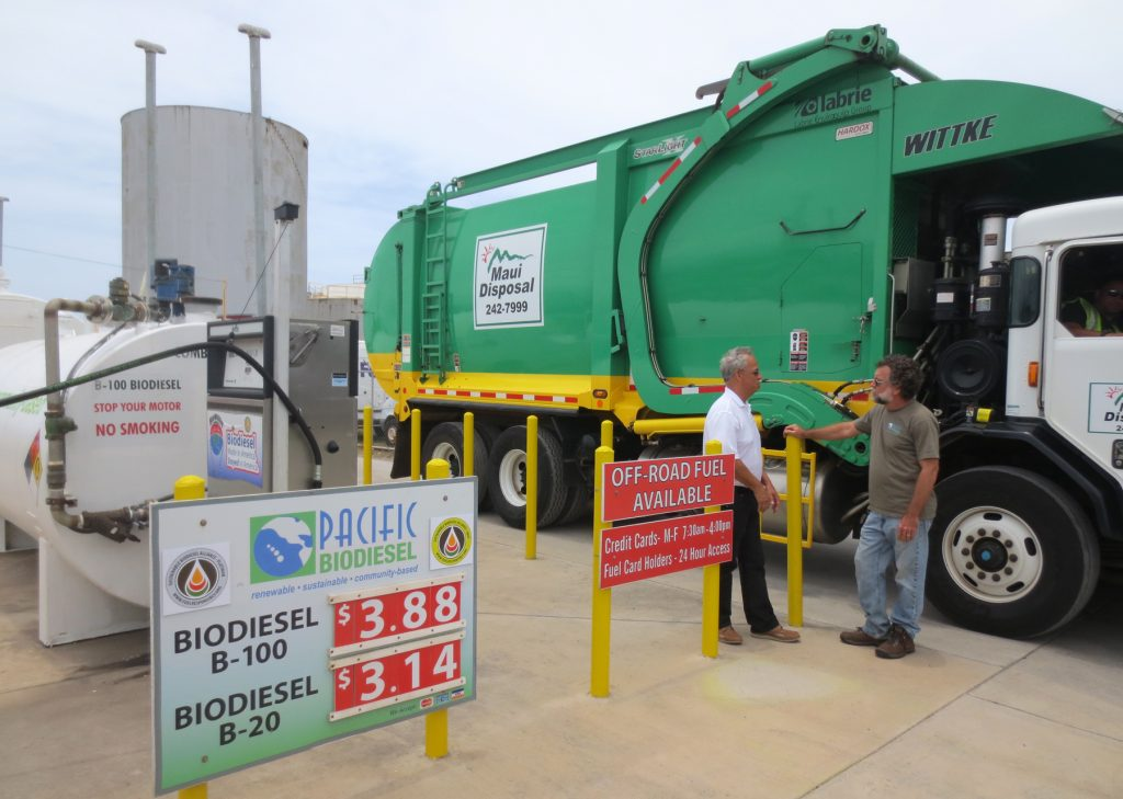 Rick Miller, vice president of operations for Maui Disposal, talks with Pacific Biodiesel President Bob King during today's event as one of his trucks fuels up at the Pacific Biodiesel pump in Kahului. All Maui Disposal diesel vehicles run on biodiesel.Photo credit: Pacific Biodiesel