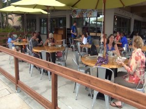 Outdoor seating at Fork & Salad, surrounded by a hand-crafted redwood railing. Courtesy photo.