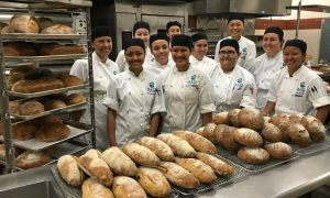Baking students at UHMC and their freshly-baked bread.  Courtesy photo.