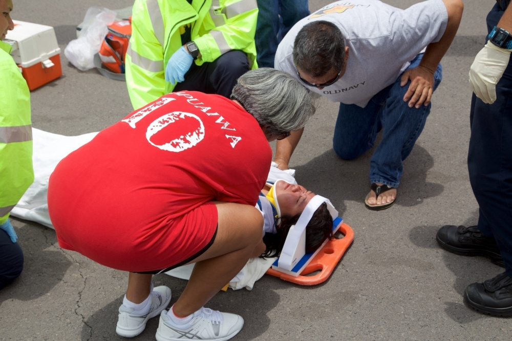 The mother of Sidney Uemoto checks on her daughter following her daughter's rescue nine miles off Kona, Hawaii, July 15, 2016. Uemoto and David McMahon were both rescued by a Coast Guard MH-65 Dolphin helicopter crew following an expansive joint search by Navy, Royal New Zealand air force, U.S. Air Force and Coast Guard crews. (U.S. Coast Guard photo by Lt. Cmdr. Kevin Cooper/Released)