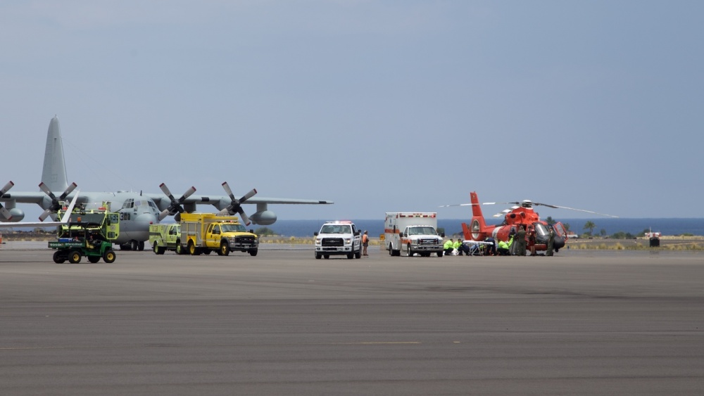 Coast Guard crews safely deliver David McMahon and Sidney Uemoto to emergency medical personnel in Kona, Hawaii, July 15, 2016, following their rescue nine miles off Kona. They were both rescued by a Coast Guard MH-65 Dolphin helicopter crew following an expansive joint search by Navy, Royal New Zealand air force, U.S. Air Force and Coast Guard crews. They reportedly sustained only minor injures in the crash. (U.S. Coast Guard photo by Lt. Cmdr. Kevin Cooper/Released)