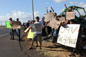 On Friday, July 8, over 60 motocross enthusiasts participated in a sign waving demonstration along Mokulele Highway. Photo: Tiare Lawrence