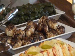 Stuffed grape leaves, roasted whole garlic and hummus with Hungarian paprika. Photo by Kiaora Bohlool.
