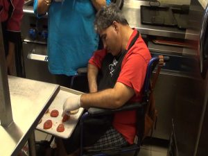 Easter Seals participant helps in the kitchen at Sugar Beach Events. Photo by Kiaora Bohlool.