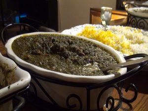 Persian vegetable topping known as Khoresht-e Qormeh Sabzi with lamb. Photo by Kiaora Bohlool.