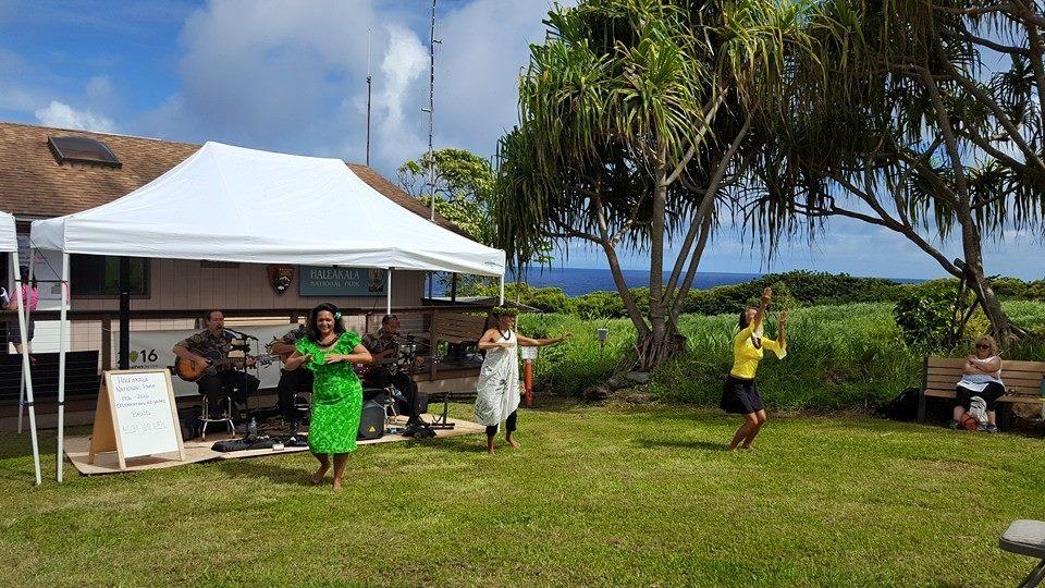 Maile Bryan, Wainani Kealoha, and Amy dance while Nevah Too Late performs. Photo courtesy Haleakalā National Park.