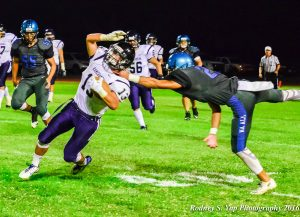King Kekaulike defensive back Dylan Poouahi grabs the horse collar of Kamehameha Maui's Trystin Catan during first-half action Thursday at King Kekaulike Stadium.m Photo by Rodney S. Yap.