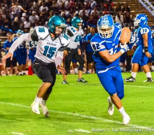 Maui High's Mark Ranchez (82) catches this pass in front of King Kekaulike defenderKayden Mckinnon (15). Photo by Rodney S. Yap.