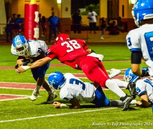 Lahainaluna's Mosese Felemi (38) tackles Maui High running back Isaiah Grijalva in the end zone Friday for a two-point safety. The two points were the only points Lahainaluna scored, losing 14-2. Photo by Rodney S. Yap.
