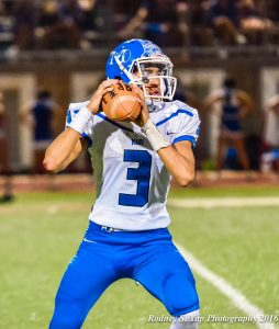 Maui High quarterback John Michael Mokiao-Duvauchelle looks for an open receiver during second-half action Friday at Lahainaluna. Photo by Rodney S. Yap.