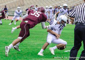 Baldwin High School's Nainoa Keahi sacks Kamehameha Kapalama quarterback Justice Young early in the second quarter Saturday. Photo by Rodney S. Yap.