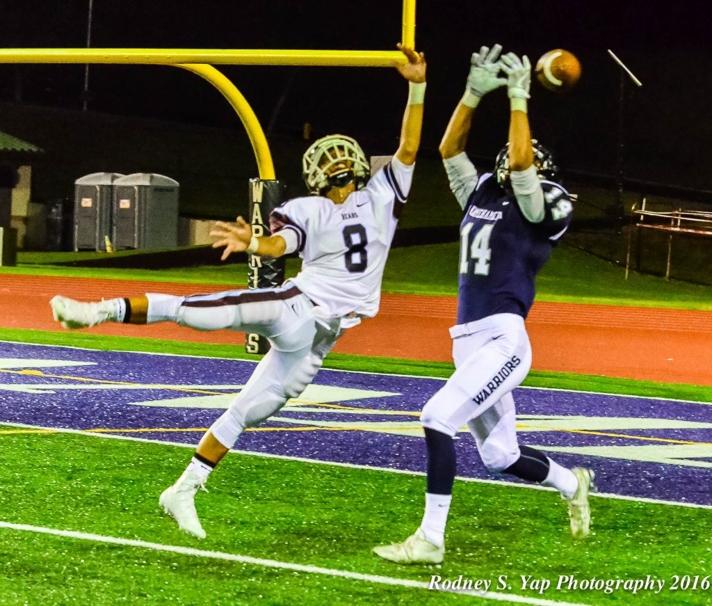 Baldwin's Jansen Roldan breaks up this pass intended for Kamehameha Maui's Nathan Facuri. Photo by Rodney S. Yap.