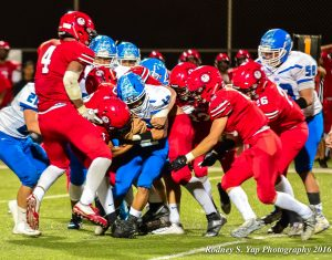 Lahainaluna's defense swarms all over Maui High during second-half action Friday at Sue Cooley Stadium. Photo by Rodney S. Yap.