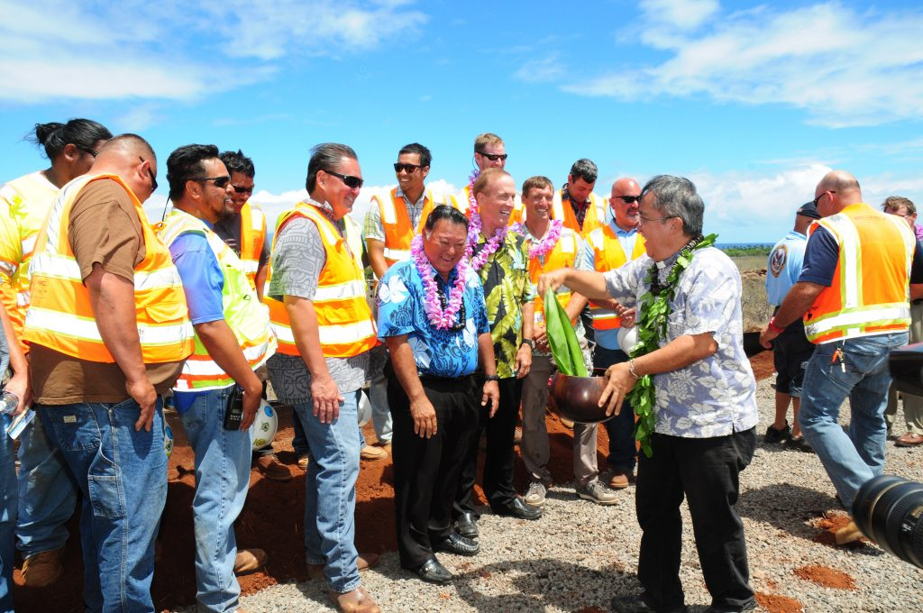 Reverend Alika blesses some of the crew that will be working on the West Maui Hospital and Medical Center project. Mayor and hospital developer (on the right of the Mayor) pictured in the middle.