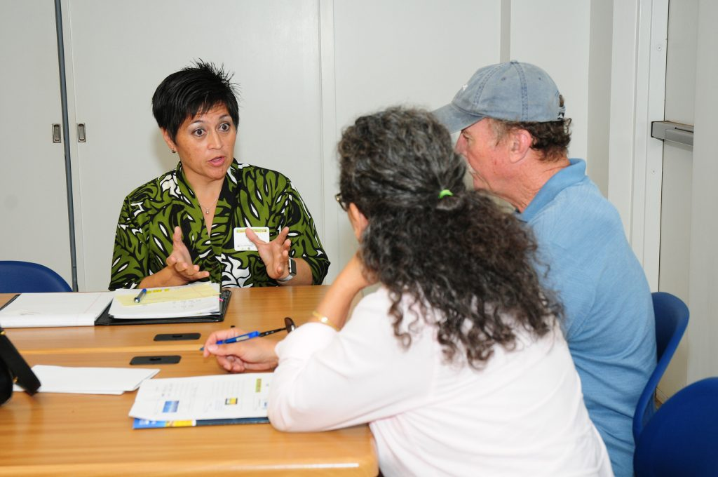Workshop attendees took advantage of one-on-one consultations with USDA representatives (Denise Oda pictured) about their specific projects.