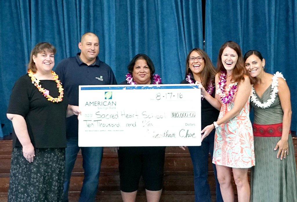 ASB teammates from the Lahaina Branch present a $10,000 grant to Sacred Hearts School of Maui for the school's playground improvement project. From left: Becky Spitznagel, Principal, Sacred Hearts School of Maui; Aric Becker, ASB Assistant Branch Manager; Denise Akana, ASB Teller Supervisor; Bonnie West, ASB Branch Manager; Paula Lair, Campaign Chair; and Yvette Richard, Development Director, Sacred Hearts School of Maui.