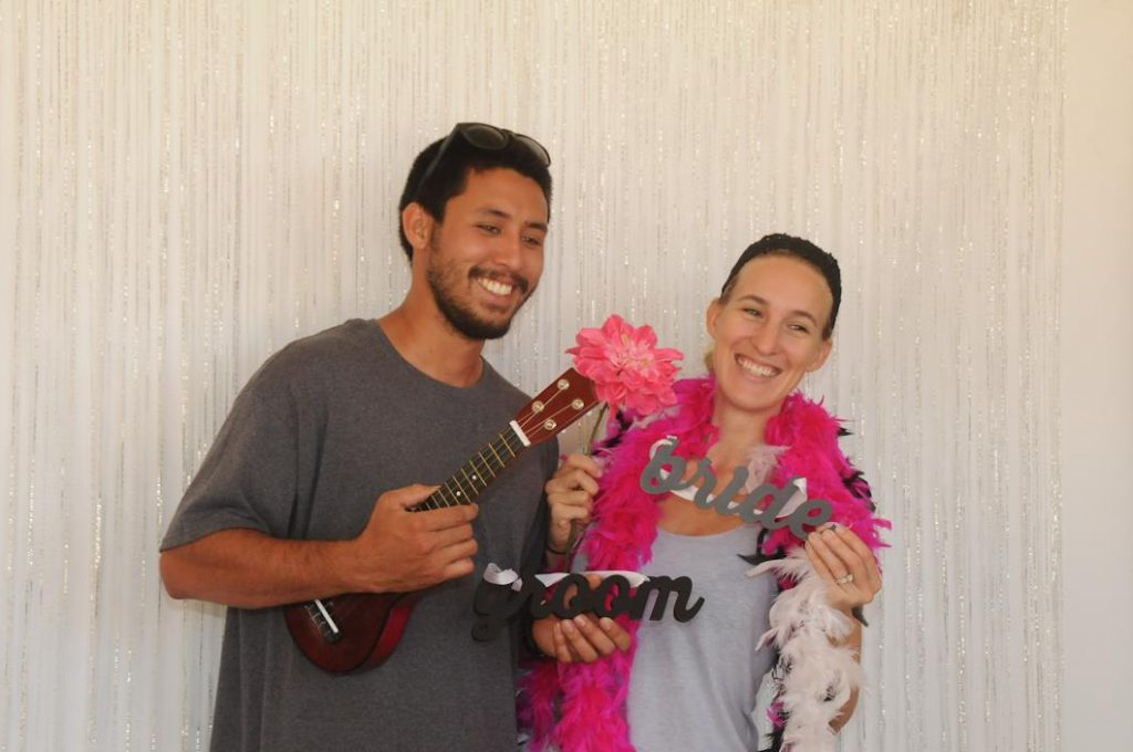 Brides and Grooms check out the free photo booth put on by Epic Entertainment Hawaii at the 21st Annual Maui Wedding Expo.