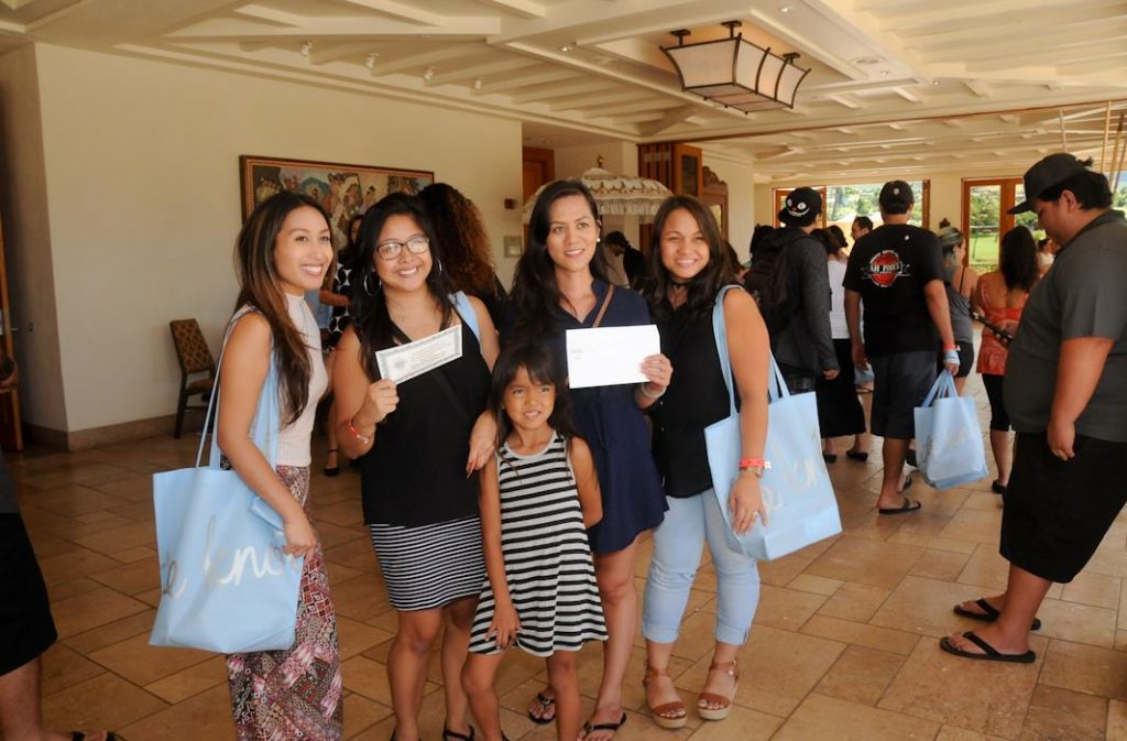 Winners show their door prizes won at the 21st annual Maui Wedding Expo.