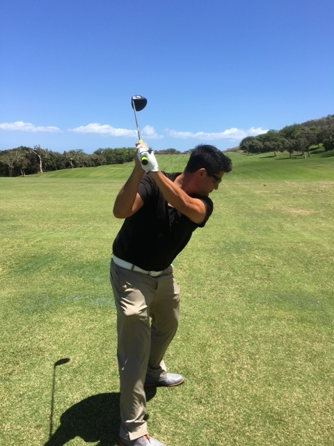 PHOTO 6:Now at the top of the swing the club face is closed as you can see the club face is pointing up at the sky.