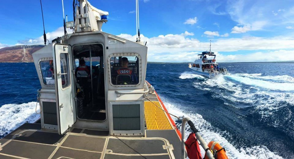A Coast Guard Station Maui 45-foot Response Boat-Medium crew escorts the commercial passenger vessel Maka Koa back to port five miles south of Maalaea, Maui, Aug. 14, 2016. The Coast Guard responded to a report of the 43-foot vessel, with 21 people aboard, taking on water off Maui. (U.S. Coast Guard photo by Petty Officer 2nd Class Rob Lester/Released)
