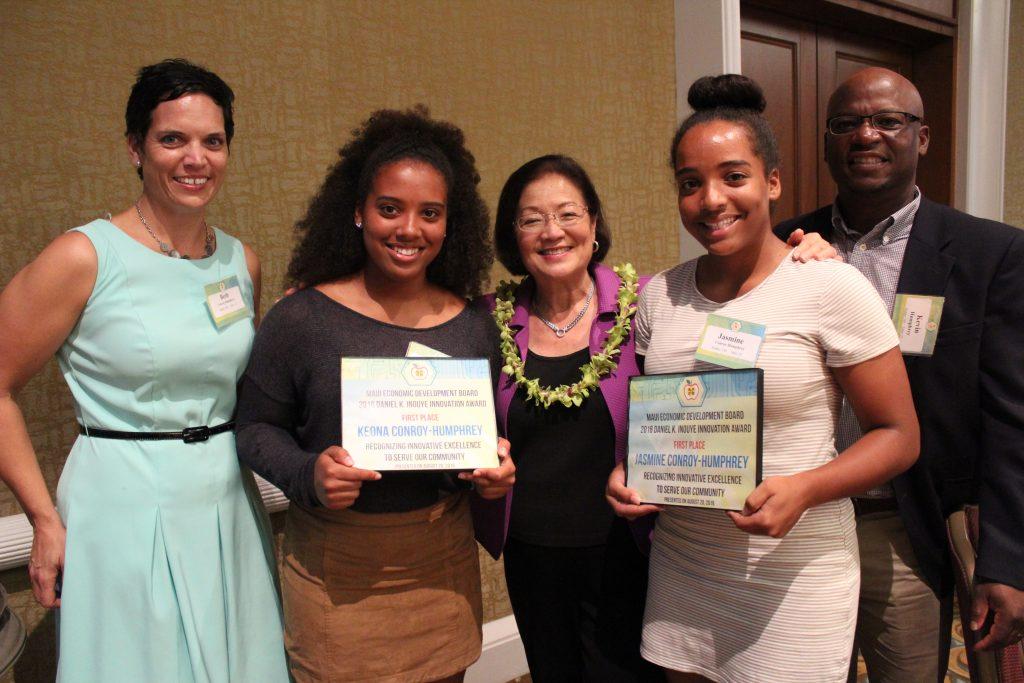 Senator Hirono and Daniel K. Inouye Innovation Award winners Keona (left) and Jasmine (right) Conroy-Humphrey from Lānaʻi High School, and their parents.
