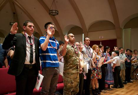 77 candidates representing 26 countries are sworn in as new American citizens today at Mission Memorial Auditorium.