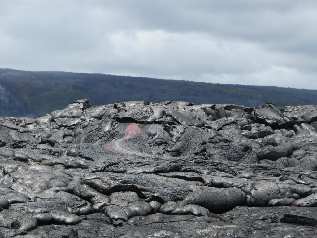 Upslope of the ocean entry, sluggish pāhoehoe lava continued to break out in several places along the margins of the flow. (8.2.16) Photo courtesy: USGS/HVO