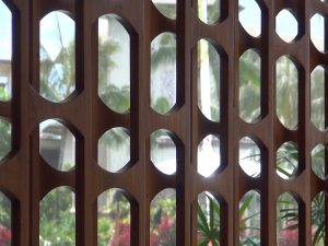 Carved wooden screens, symbolizing what sugar cane looks like under a microscope. Photo by Kiaora Bohlool.