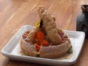 Cane & Canoe's version of chicken and waffles as part of its Sunday brunch menu. Photo by Kiaora Bohlool.