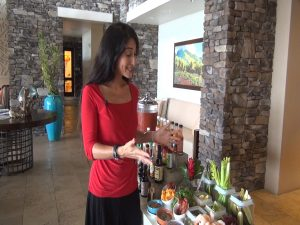 Maui Now's Kiaora Bohlool explains the build-your-own Bloody Mary bar at Cane & Canoe.