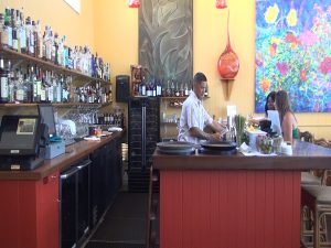 Bartender in action during happy hour at Hali'imaile General Store, Monday through Friday from 3 to 5:30 p.m. Photo by Kiaora Bohlool.