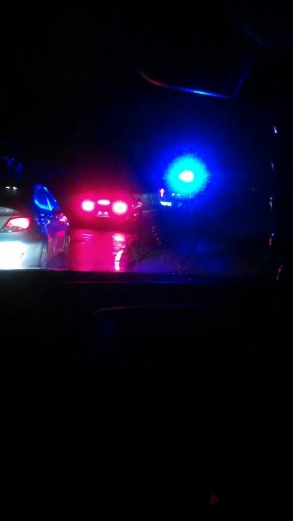 A polcie officer blocked off the town bound lane of traffic by the contraflow stop lights due to a landslide at 9:10 p.m. on Saturday, Sept. 3, 2016. Photo credit: Kristi Souza