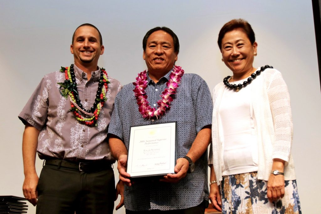 Edgar Yoshida, Baldwin High School, Maui District (middle) wins the DOE's Sustained Superior Performance Award.