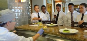 Chef Teresa Shurilla explaining dessert to student servers at Leis Family Class Act Restaurant on the first day of service this season. Courtesy photo.
