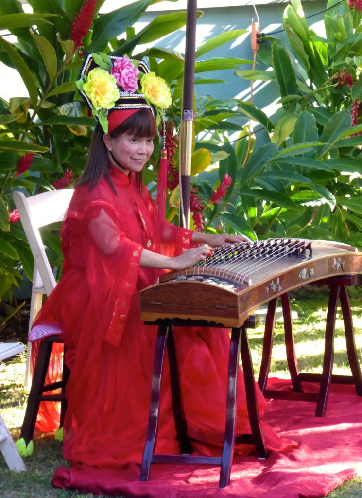 Toi performing on the gu zheng harp, a traditional Chinese instrument, at the Moon Festival in Lahaina. Photo courtesy: Lahaina Restoration Foundation.
