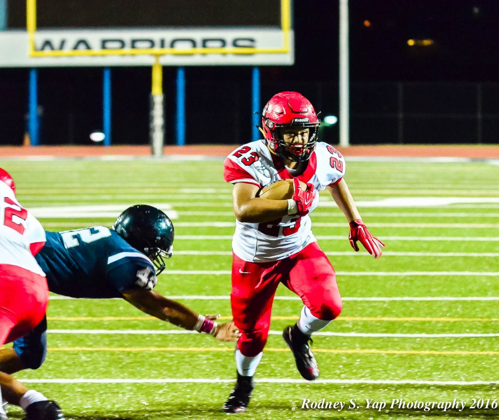 Lahainaluna's Dean Miyamoto helps set up the Lunas' second touchdown of the night. Photo by Rodney S. Yap.