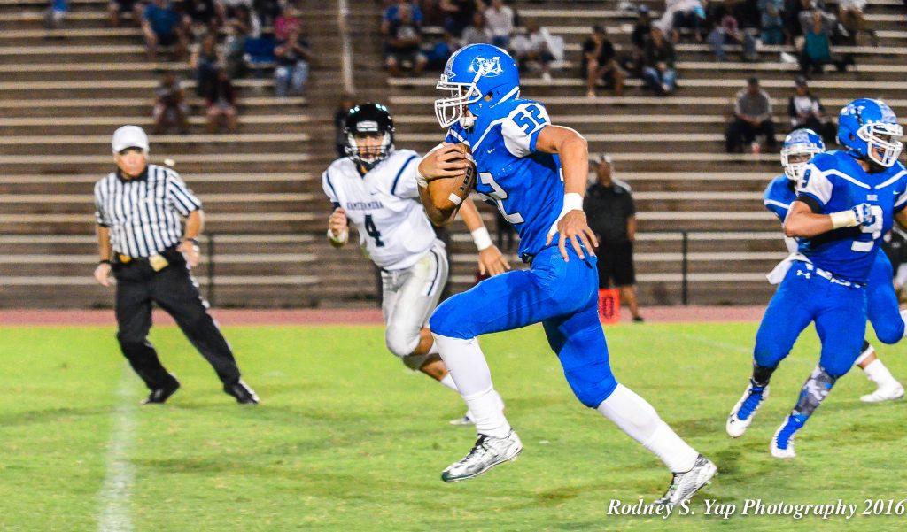 Maui High School's Jamie Elisara-Fisher (52) makes a break for the end zone after intercepting Kamehameha Maui quarterback Kainoa Sanchez (4). Photo by Rodney S. Yap.