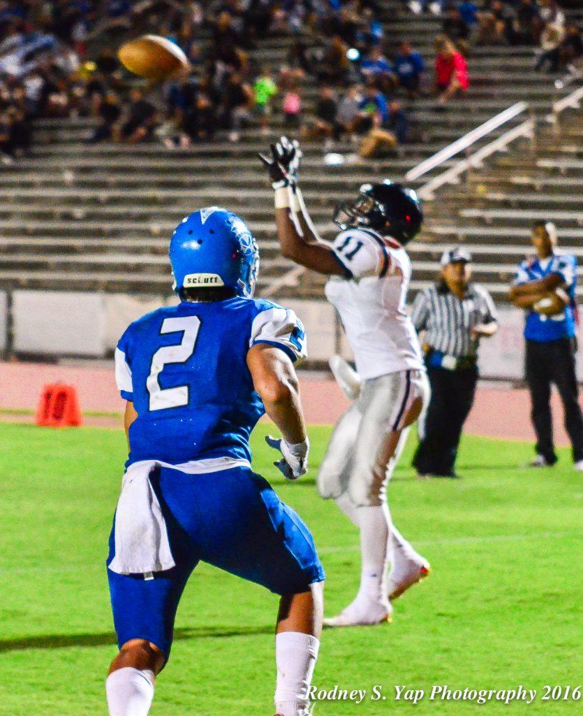 Kamehameha Maui's Tyerell Baldonado-Kaleiopu (11) cacthes this 4-yard touchdown pass from teammate Kainoa Sanchez Saturday at War Memorial Stadium. Photo by Rodney S. Yap.