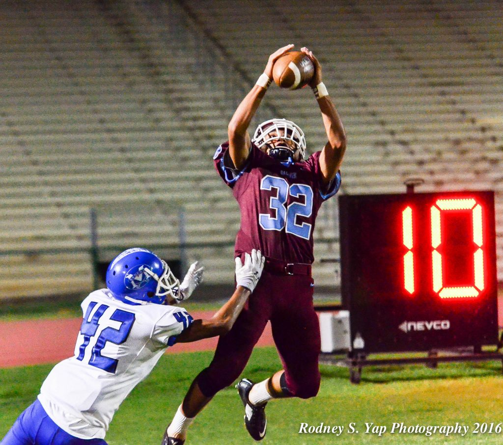 Baldwin's Kainalu Lacno goes up for this 27-yard touchdown catch in the third quarter against Maui High on Monday. Defending on the play is Maui High's Tevita Takitaki Jr. (42). Photo by Rodney S. Yap.