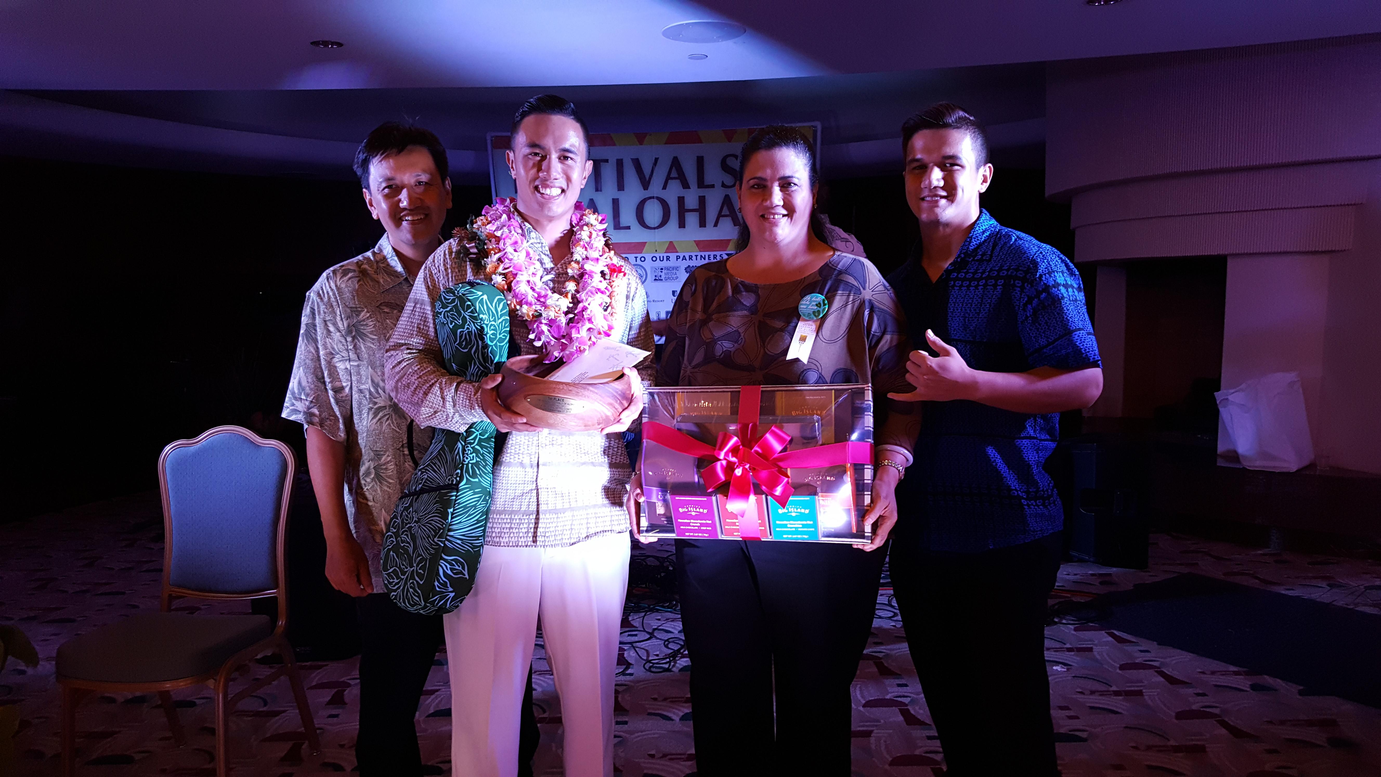 Gregory James Kahikina Maikalani Maxwell Juan with his ʻohana at the 15th Richard Hoʻopiʻi Leo Kiʻekiʻe Falsetto Contest.  PC: Daryl Fujiwara