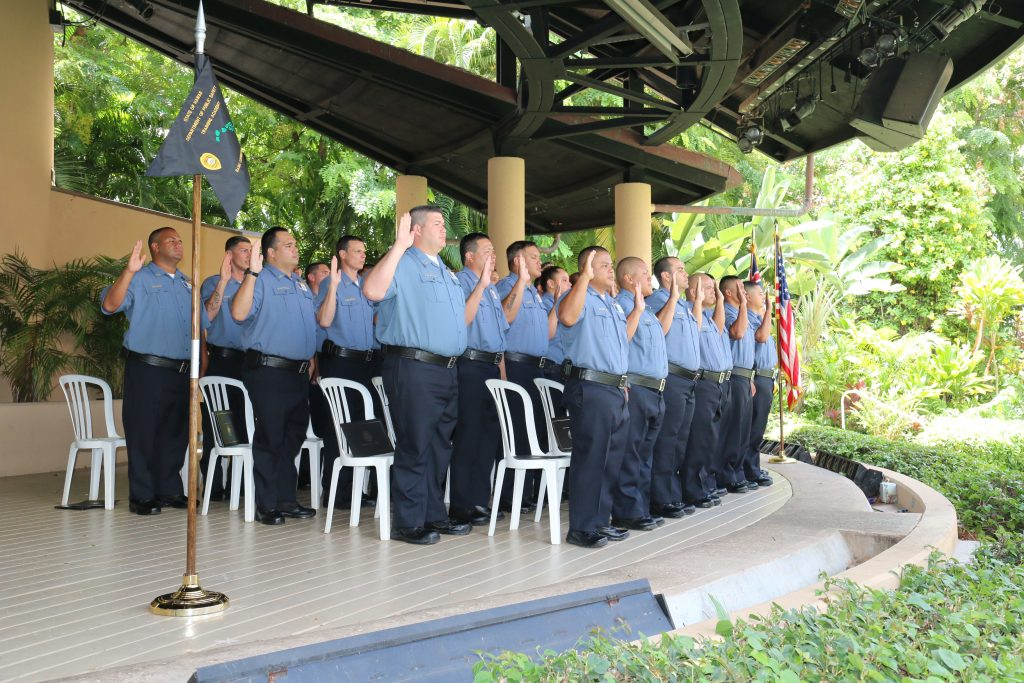 Recruits taking the oath of duty during their graduation ceremony. Photo: DPS.
