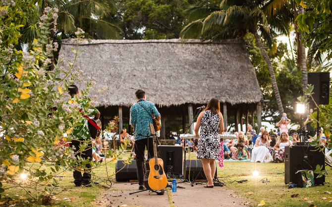 Trio of rising star musicians from Maui perform during Moku'ula by Moonlight in Kamehameha Iki Park, Lahaina.