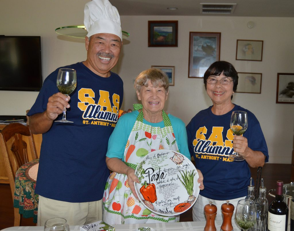 From left, St. Anthony 1972 graduate Alvin Imada; Jan Arensdorf; and Jackie Davis, St. Anthony '62, alumni. Arensdorf and Davis donate all the items for the annual Pasta Table door prize drawing at the St. Anthony Junior-Senior High School Strength In Unity Gala. This year's event will be held from 5 to 9 p.m. Friday, November 11, at the Kamehameha Golf Clubhouse in Waikapū.