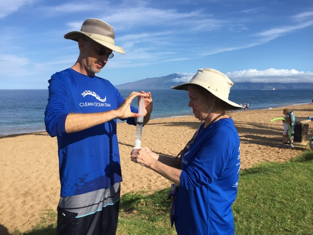 Citizen-science volunteers Ty Freiberg (left) and Marie Schroeder (right) collect water quality samples on Maui as part of the island's newly launched Hui O Ka Wai Ola water quality monitoring program.
