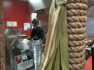 Cooking in the kitchen at Da Shrimp Hale in Maui Mall. Photo by Kiaora Bohlool.