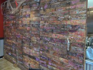 Wall with customers' names and signatures at Da Shrimp Hale in Kahului. Photo by Kiaora Bohlool.