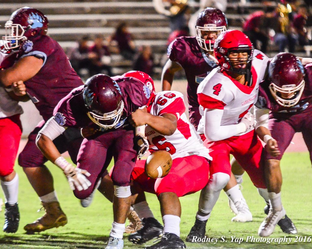 Lahainaluna's Viliami Hafoka rips the football out of the hands of Baldwin quarterback Chayce Akaka near the goal line Saturday at War Memorial Stadium. Photo by Rodney S. Yap.
