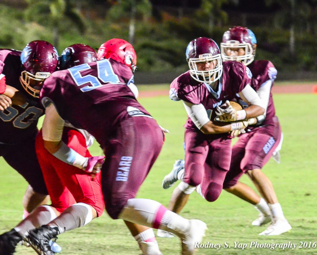 Baldwin's Daniel Corpuz runs behind the block of lineman Jared Paranada en route to a 1-yard touchdown run Saturday against Lahainaluna. Photo by Rodney S. Yap.