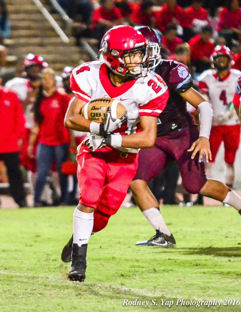 Lahainaluna's Elijah Ragudo sxored his team's only touchdown on a 43-yard run in the third quarter Saturday. Photo by Rodney S. Yap.
