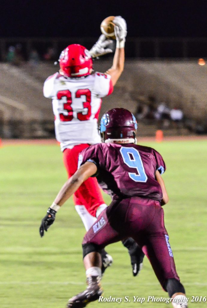 Lahainaluna's Joshua Tihada could not hang on to this pass as Baldwin's Damien Defrancia closes in to break up the play. Photo by Rodney S. Yap.